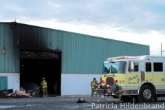 1.19.11..Patricia Hildenbrand Photo..Members of the Hurlock Fire Department and surrounding areas work to put out a blaze that damaged the main warehouse of the Black Gold Potato Farm in Rhodesdale. Fourteen fire companies and one hundred firefighters responded to the three-alarm fire.  No injuries have been reported and the cause of the fire is still under investigation.