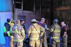 1.19.11..Patricia Hildenbrand Photo..Firefighters inspect a building after putting out a blaze that damaged the main warehouse of the Black Gold Potato Farm in Rhodesdale. Fourteen fire companies and one hundred firefighters responded to the three-alarm fire.  No injuries have been reported and the cause of the fire is still under investigation.